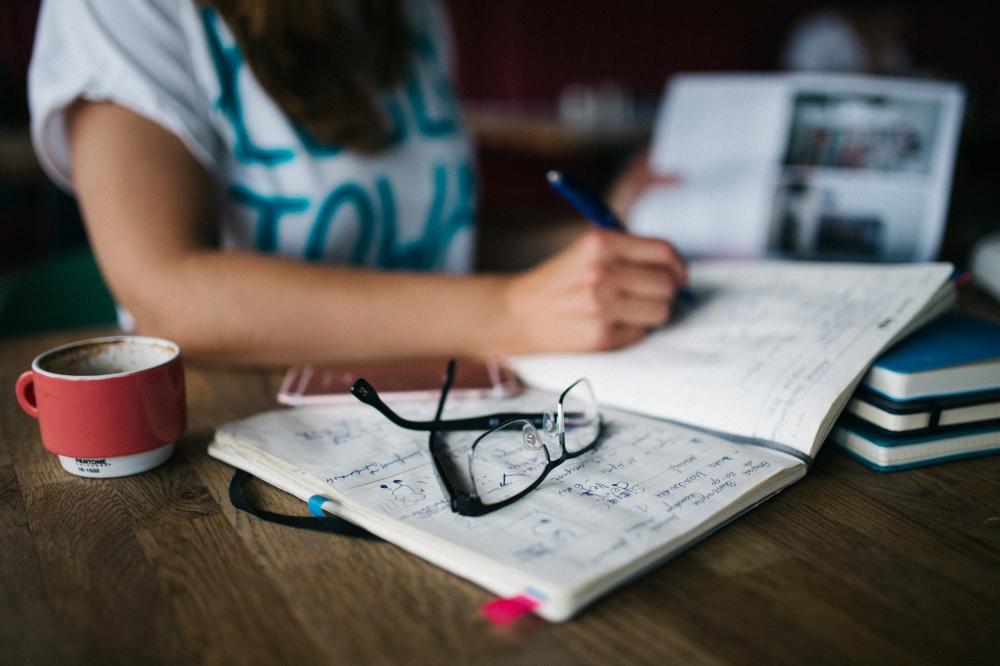 kaboompics.com_Woman writing  in her work space.jpg